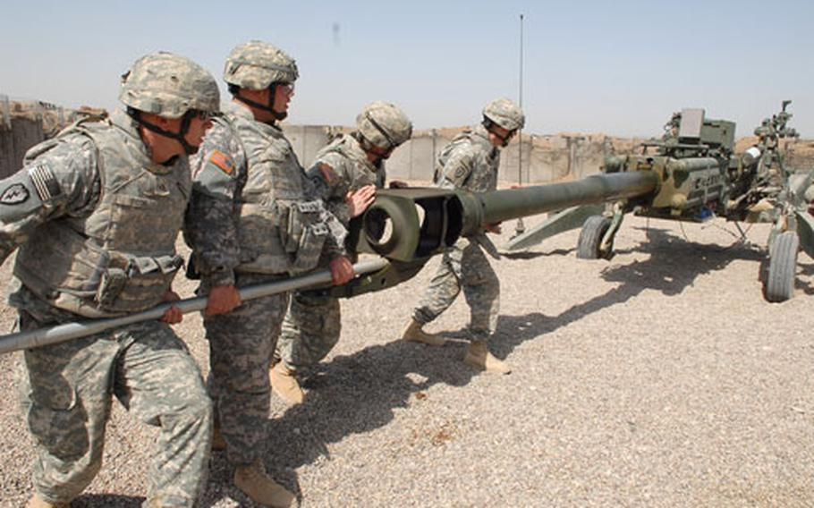 Soldiers with 2nd Battalion, 11th Artillery Regiment move a M-777 howitzer at Camp Taji, Iraq, during a firing drill that required them to re-orient the cannon. Artillerymen have been spending less time handling guns like this as they've taken on more unrelated jobs.