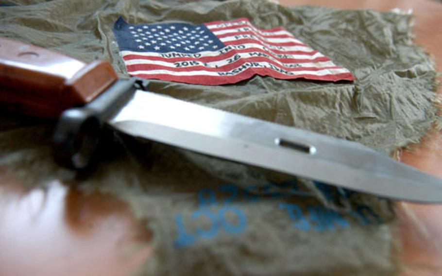 A piece of the parachute that landed him safely in Iraq during the invastion in 2003 is one souvenir Chief Master Sgt. Robert Henson keeps of the part he played in the war. An Iraqi knife is another. With 19 other airmen, Henson parachuted into Iraq with 173rd Airborne Brigade soldiers in March 2003 to set up an essential airfield.