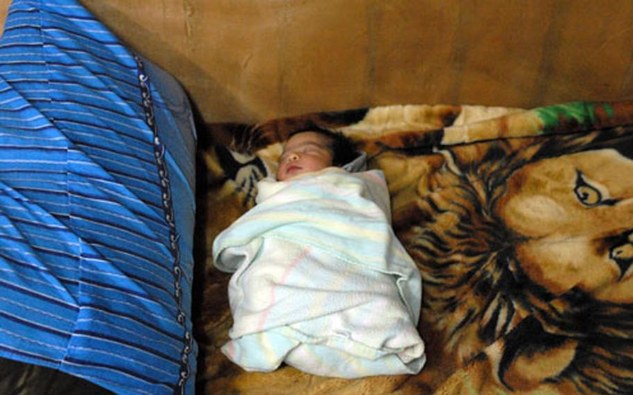 """After it was dropped off in a plastic bag near Forward Operating Base Callahan in Baghdad, a baby boy was cared for by U.S. soldiers. They nicknamed the boy """"Alex Callahan"""" after the soldier who found him and the base where he was left."""