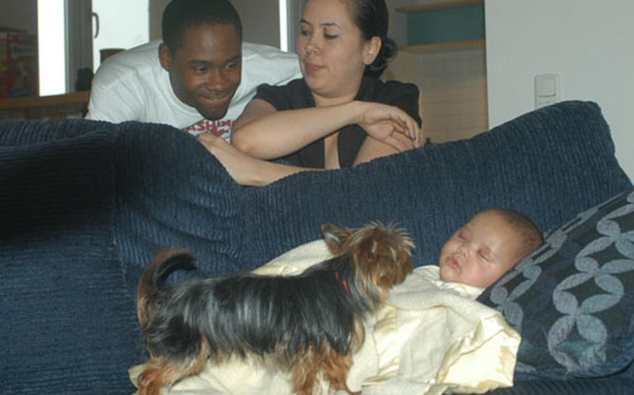 Larry Thomas at home with his wife, Jamie, their son, Kaymon, and dog, Max.