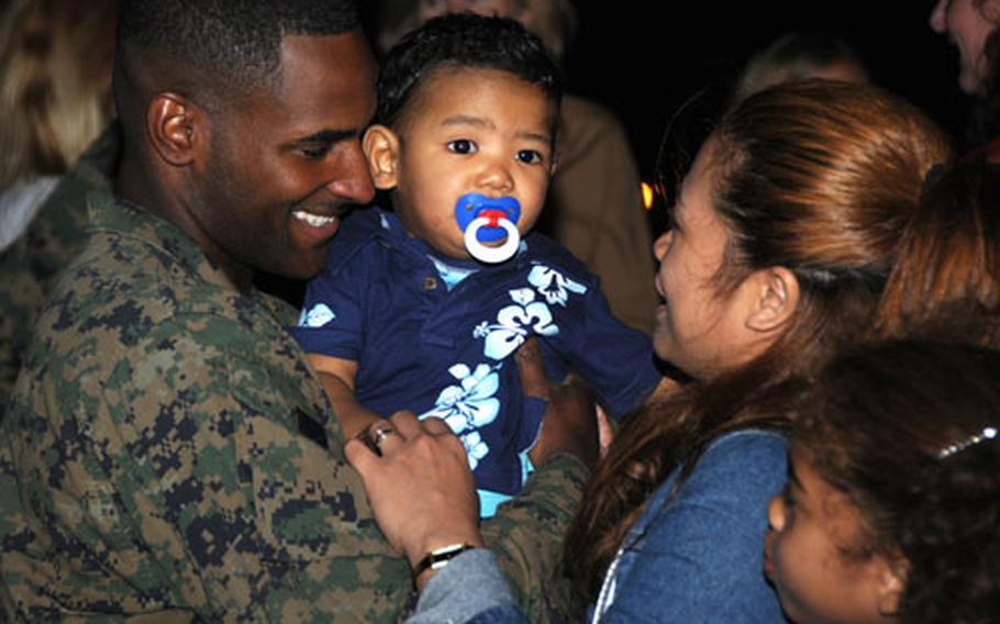 A 3rd Marine Division servicemember greets his family Wednesday at the Camp Courtney Chapel after returning to Okinawa from a nine-month deployment to Afghanistan.