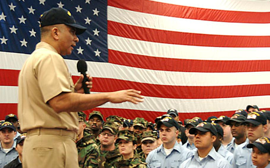 Master Chief Petty Officer of the Navy Joe R. Campa Jr. talks to sailors about leadership in the hanger bay of the USS Kitty Hawk on Thursday at Yokosuka Naval Base, Japan.