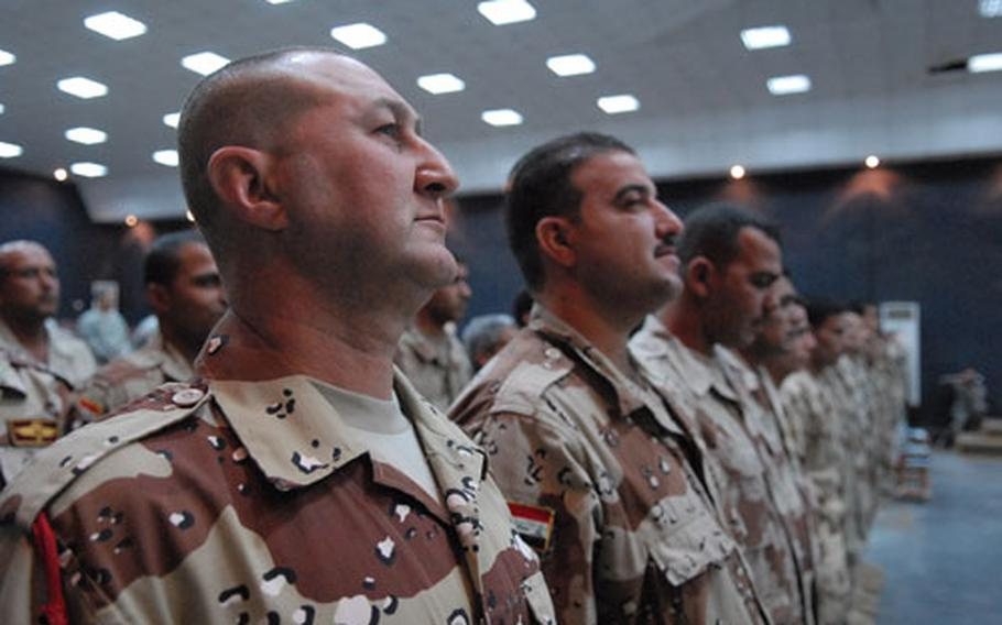 Iraqi Army Sgt. Yousef Yacob stands at attention Sunday in Taji, Iraq, at the beginning of a graduation ceremony for students in the master trainer's course. The course aims to teach noncommissioned officers so that they can train their fellow soldiers.