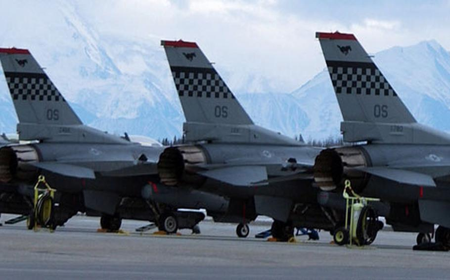Ten F-16 fighting falcons sit on the tarmac late into the evening recently at Eielson Air Force Base, Alaska, for Operation Red Flag-Alaska. The aircraft are assigned to the 36th Fighter Squadron, Osan Air base, South Korea.