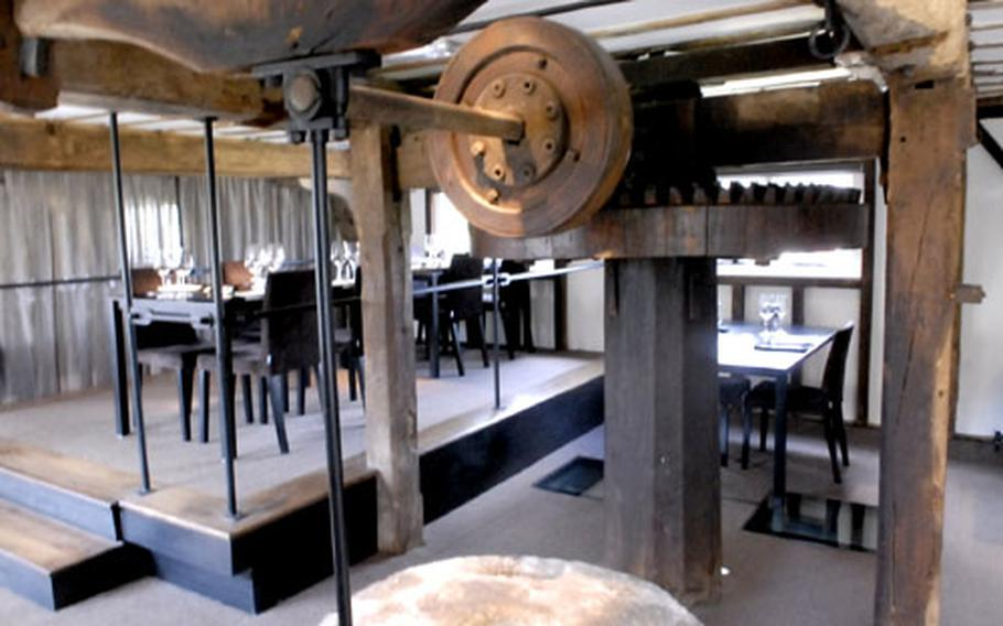 The restaurant's water mill is the centerpiece of both the upstairs dining room and the downstairs bar.