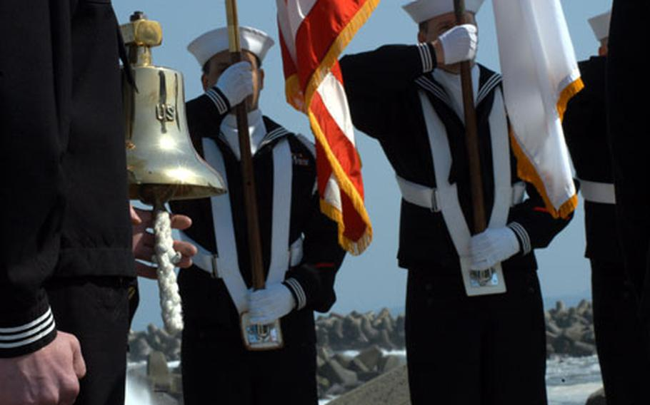 A bell was rung twice at the reading of the names of 31 servicemembers killed when their EC-121 aircraft was shot down April 15, 1969, over the Sea of Japan. Navy Information Operations Command Misawa honored the 30 fallen sailors and one Marine at a two-bell ceremony Tuesday afternoon at the Misawa Fish Port.