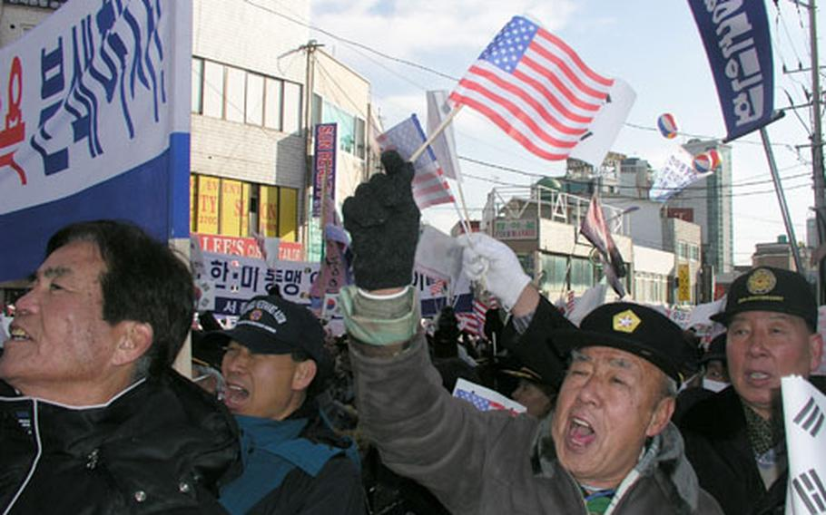 South Korean military veterans chant their support of the U.S. military in South Korea outside Osan Air Base in 2005, reflecting what experts consider an age divide in how South Koreans view America's military presence.