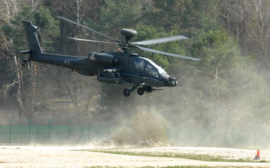A 3rd Battalion, 159th Aviation Regiment Apache attack helicopter trains at Hohenfels, Germany, on Wednesday. The battalion is preparing for an upcoming deployment to Iraq.