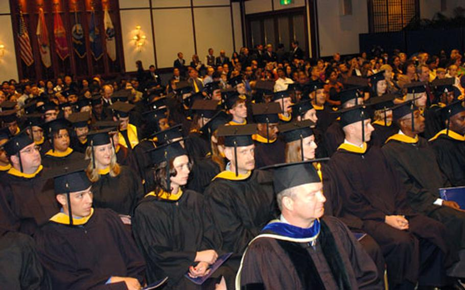 University of Maryland University College Asia graduates listen to speakers during the 52nd commencement held Saturday at the New Sanno Hotel in Tokyo.