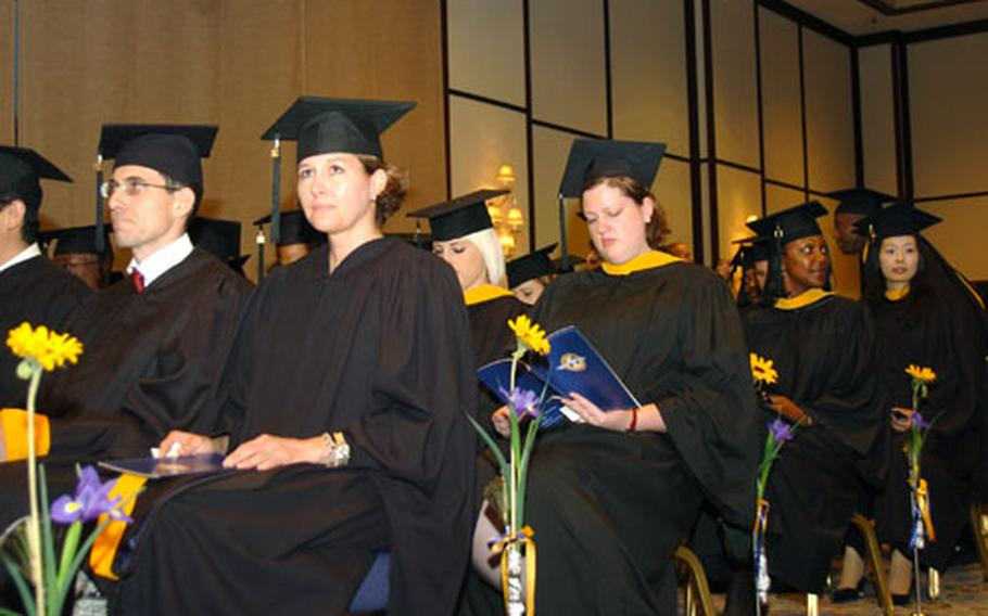 University of Maryland University College Asia graduates await for the 52nd commencement to begin Saturday at the New Sanno Hotel in Tokyo.