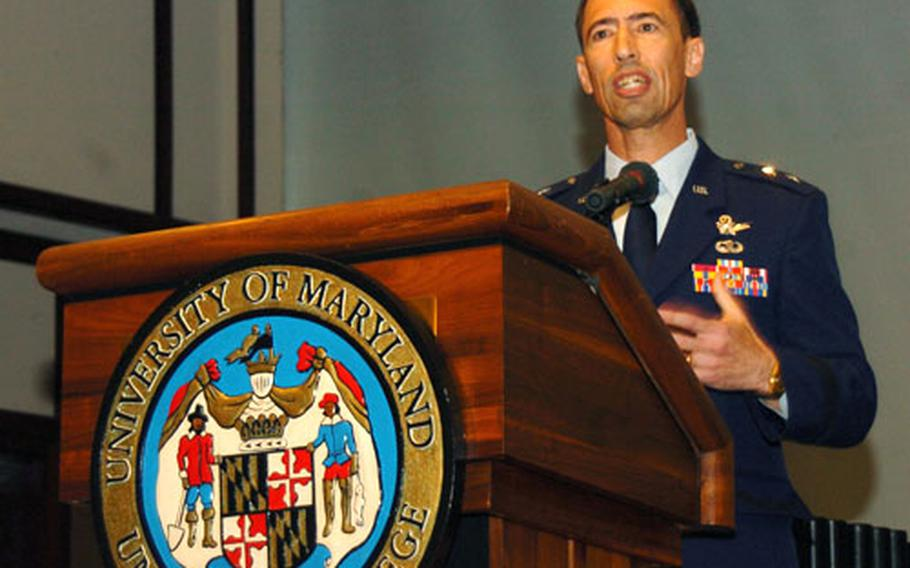 Major Gen. Larry D. James, 5th Air Force vice commander and 13th Air Force deputy commander, addresses graduates of University of Maryland University College Asia during the 52nd commencement at the New Sanno Hotel in Tokyo on Saturday.