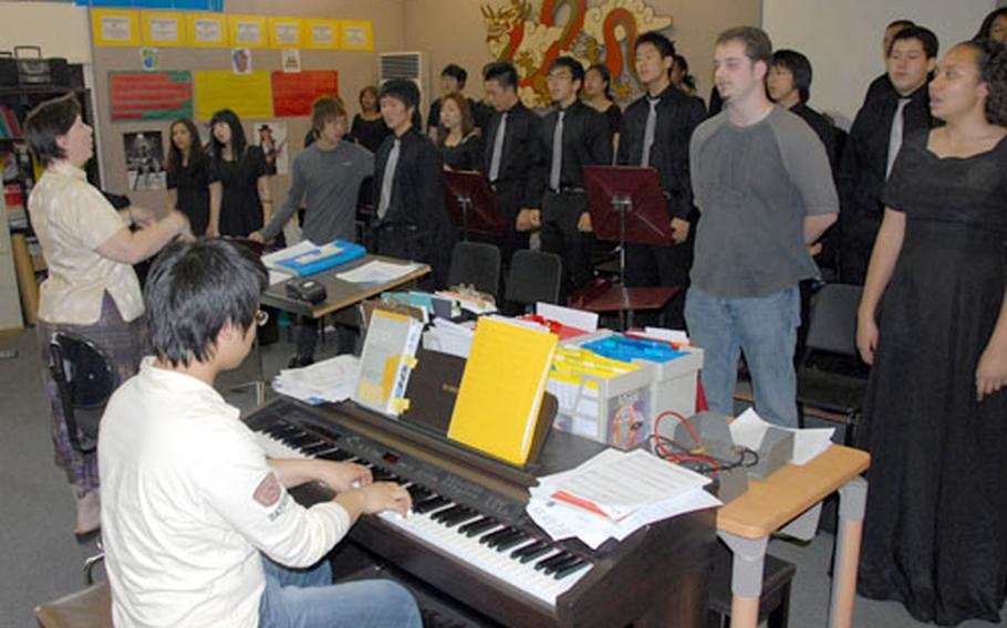 Lisa Riehle and the Seoul American High School choir practice last week for the Far East Music Festival.
