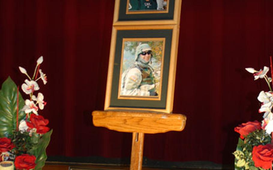Photographs of Spc. Seth Allen Miller stand at the front of Grafenwöhr, Germany's Tower Theater during a memorial ceremony Monday for the soldier, who was killed in a training accident last week.