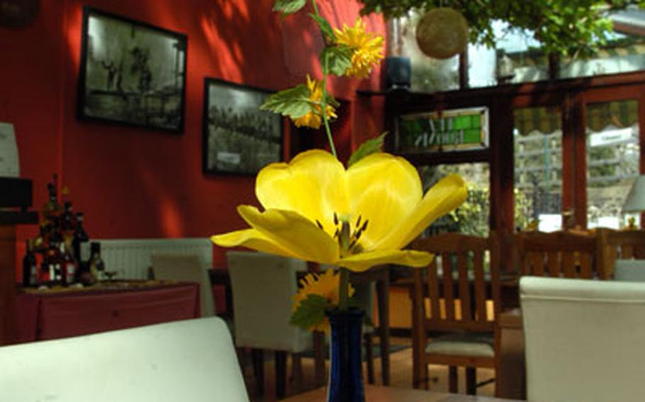 A small flower adorns one of the tables inside the Riverside Restaurant in Brandon. Fresh grapevines can also be seen draped across the ceiling.