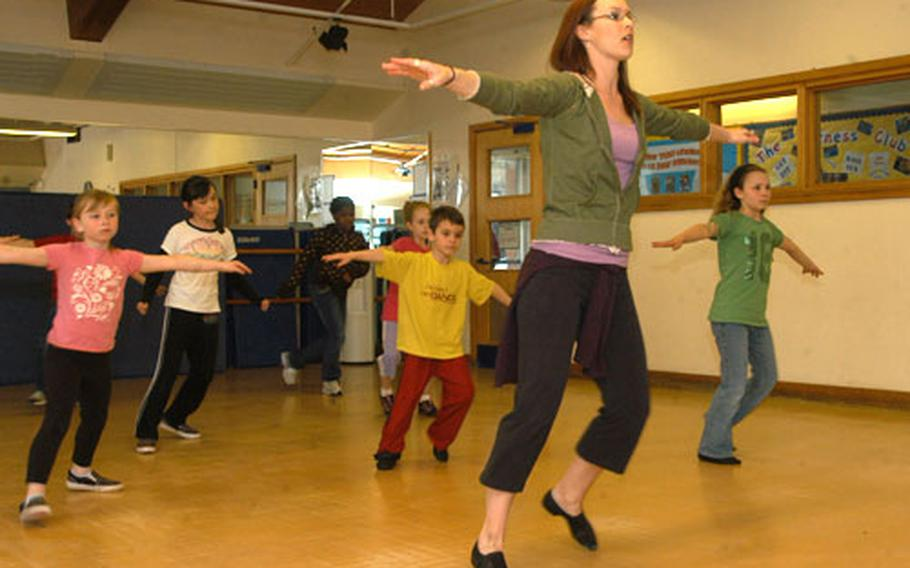 Dance teacher Jill Barranca leads a group of boys and girls in a dance routine during one of her recent hip-hop classes at RAF Mildenhall's Youth Center.