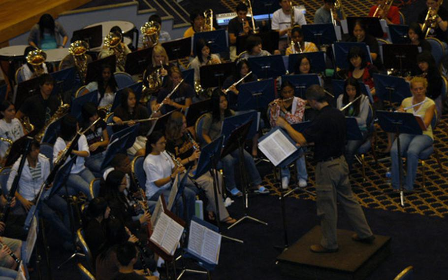 The Far East Honor Music Festival concert band rehearses Wednesday at Yokota Air Base, Japan. The 80-member group is preparing for a concert finale on Friday.