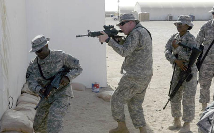 Solders with the 2nd Brigade, 1st Armored Division's Headquarters and Headquarters Company pass the time in Kuwait by running through some last minute drills. Soldiers are beginning their move into Iraq, where they are slated for a 15 month deployment.