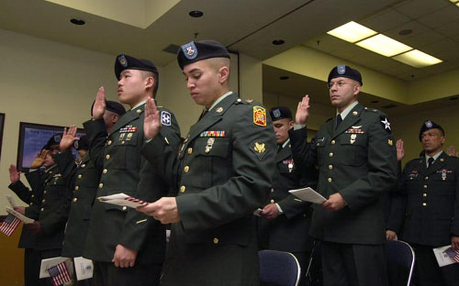 U.S. troops from 20 different countries take the Oath of Allegiance at a naturalization ceremony Friday at Yongsan Garrison, South Korea.