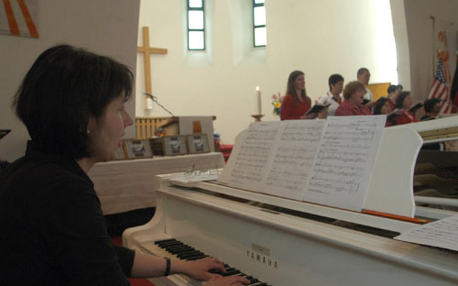 Luitgard Zotz, longtime pianist for Catholic services at the chapel on Cambrai-Fritsch Kaserne, plays during the chapel's decommissioning service Sunday. Zotz has attended services here since she was a child. Her father, Hermann Zotz, was the organist here from 1963 to 1988.