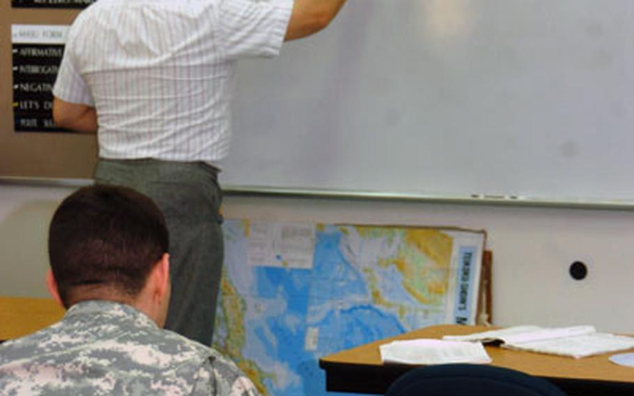 Language teacher Misuo Onozaki teaches Japanese to soldiers at the army education center on Tuesday at Camp Zama, Japan. Military service members can use foreign languages they use as credits for degrees.