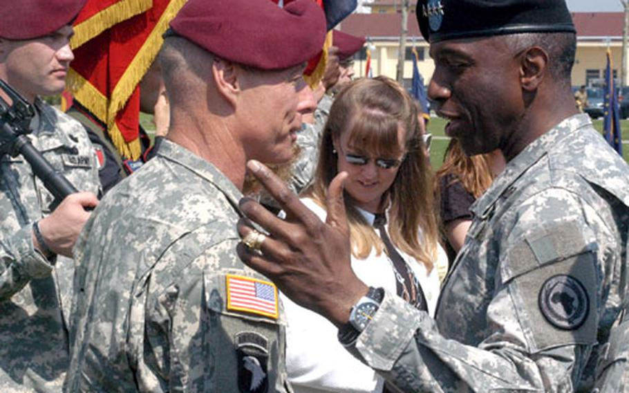 Maj. Gen. Frank Helmick, left, greets Gen. Kip Ward, commander of the U.S. Africa Command, after giving up command of the Southern European Task Force (Airborne) on Monday in Vicenza, Italy.