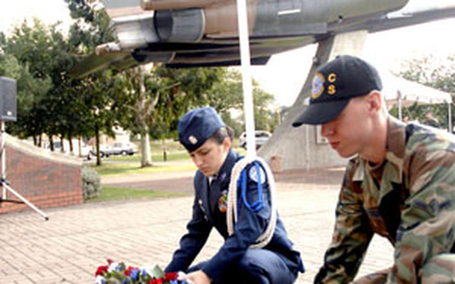 Tatiana Downey, Lakenheath High School JROTC cadet, and Airman Chad Nordrum, 48th Communications Squadron, lay wreathes as part of a POW/MIA remembrance ceremony in September. Downey's JROTC unit recently earned the 2007-2008 Air Force distinguished unit award with merit for their work in the local communities, such as this ceremony.