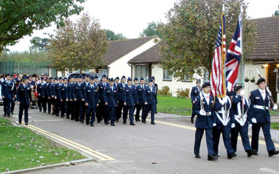 Members of Lakenheath High School's JROTC unit march in a homecoming parade last year.