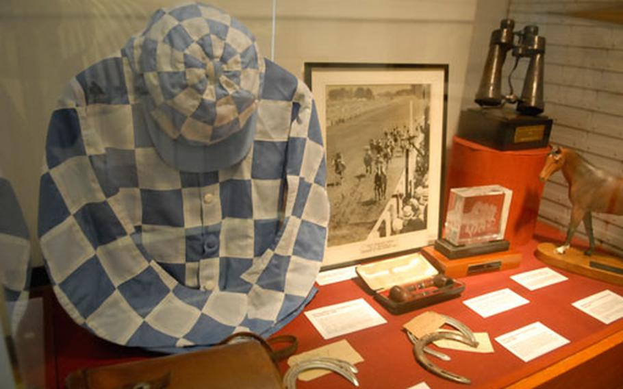 The distinct jockey uniform, gear and other race-related accouterments are part of a display at the National Horse racing Museum in Newmarket.