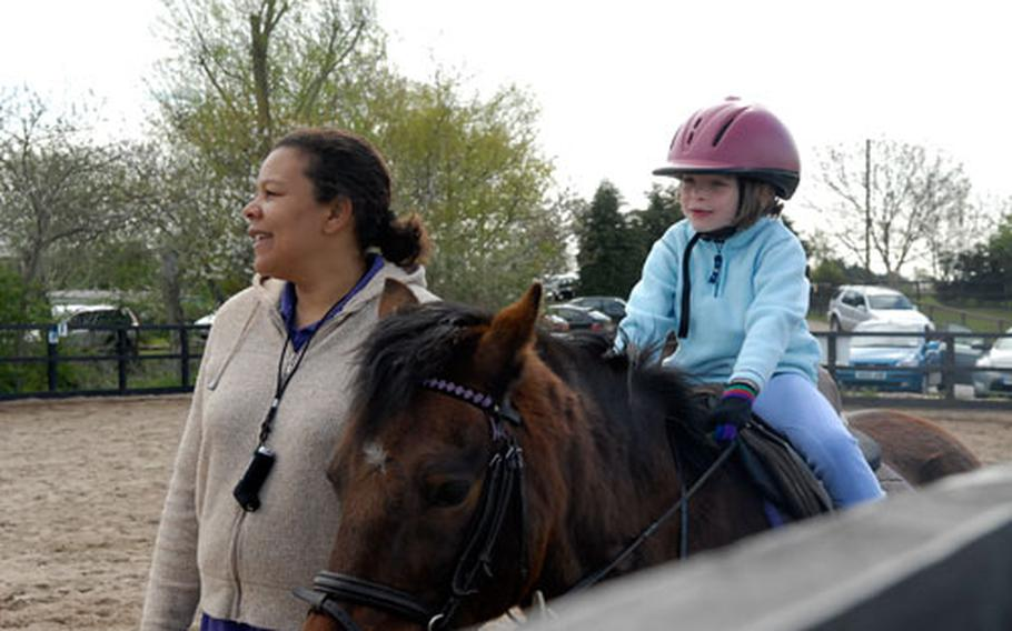 Instructor Theresa Leonard pauses during a children's riding lesson on a recent Saturday morning at Apollo Stables in Lakenheath. Leonard said the best way to teach kids how to ride is make sure they're having fun.