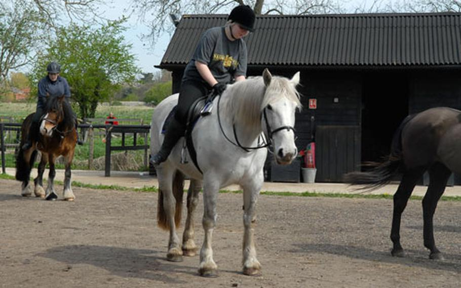 Maddy Tarrant, 17, prepares to dismount her horse after a riding lesson at Apollo Stables in Lakenheath.