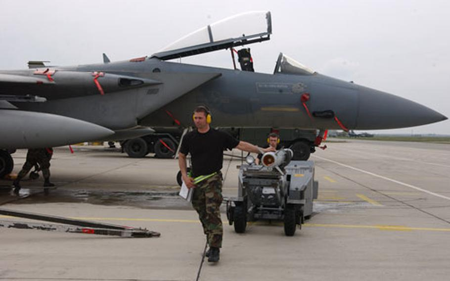 A weapon's specialist changes the aircraft's live munitions for the NATO summit in Bucharest, Romania, to training munitions in preparation for exercises that took place earlier this month with the Bulgarian air force.