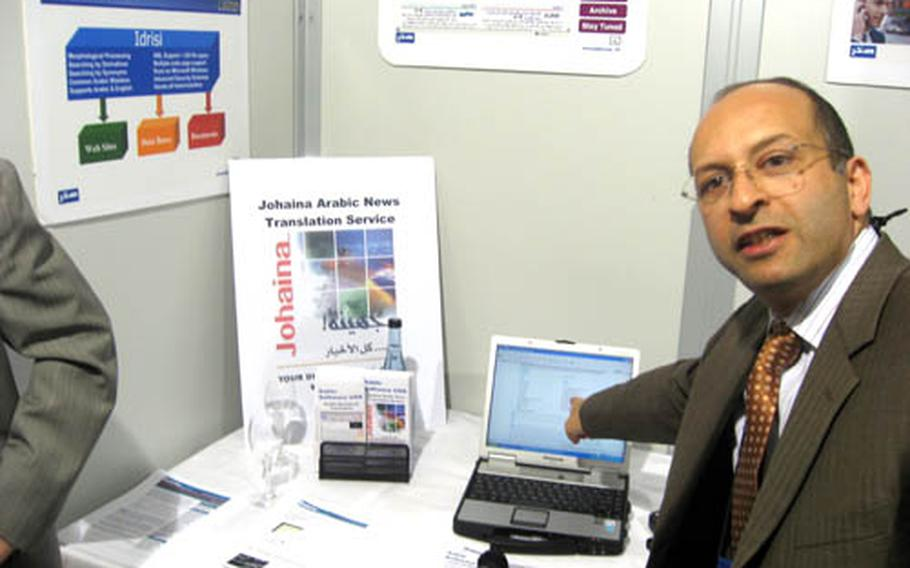 Rami Safadi, chief technical officer for Sakhr Software USA, gestures to his laptop computer where words he has spoken in Arabic have been translated into English on the computer screen and audibly through speakers. Safadi was one of the vendors on Wednesday attending the AFRICOM/Business Transformation Agency expo in Stuttgart, Germany.