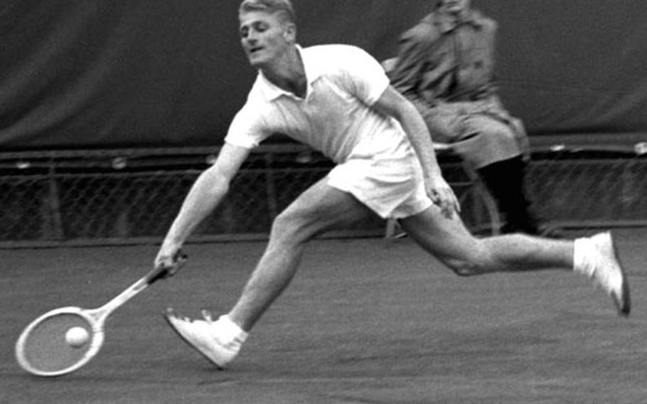Lew Hoad lunges for the ball during his singles championship match against Art Larsen at Wiesbaden in May, 1956.