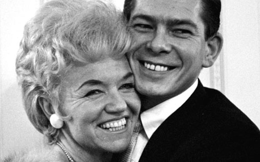 Johnnie Ray with actress Betty Reilly.