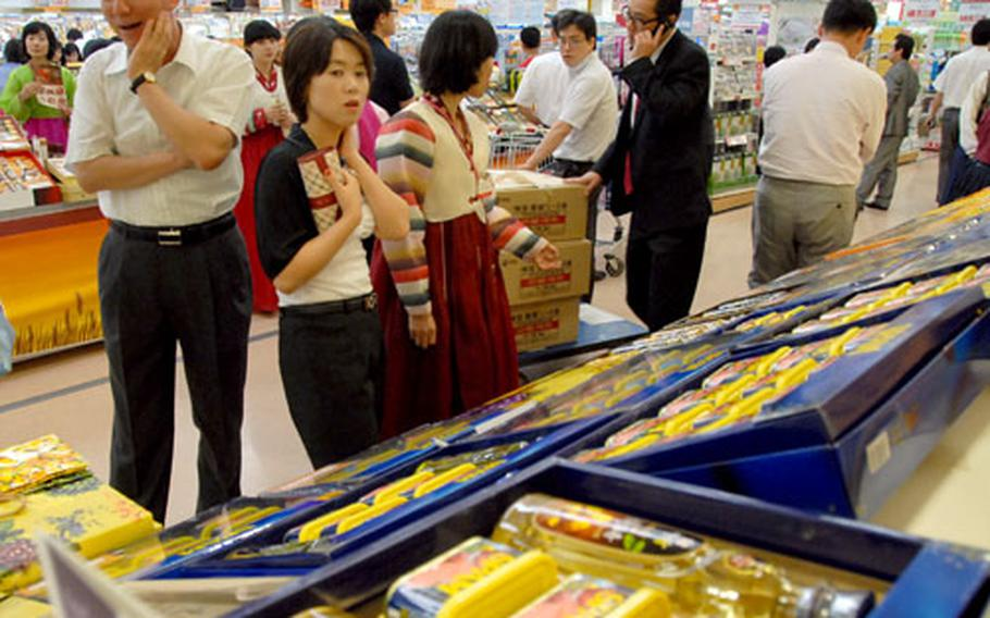 Customers at Lotte Mart at Seoul Station look at Spam gift boxes, a popular present at Chuseok.