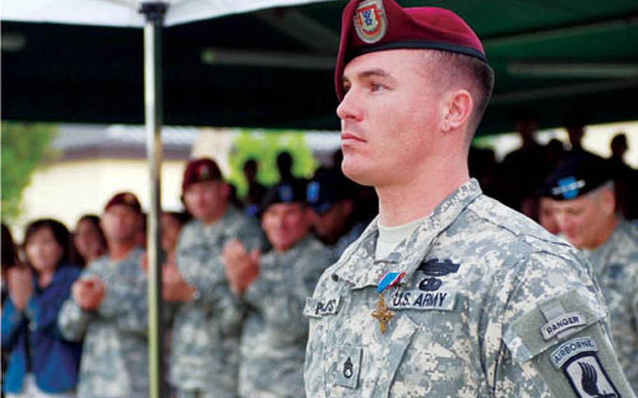 Staff Sgt. Erich R. Phillips, Mortar Platoon Sergeant for Chosen Company, 2nd Battalion, 503rd Infantry Regiment (Airborne), was awarded the Distinguished Service Cross Sept. 15, 2008 in Vicenza, Italy, for his actions at Ranch House in Nuristan Province, Afghanistan Aug. 22, 2007.