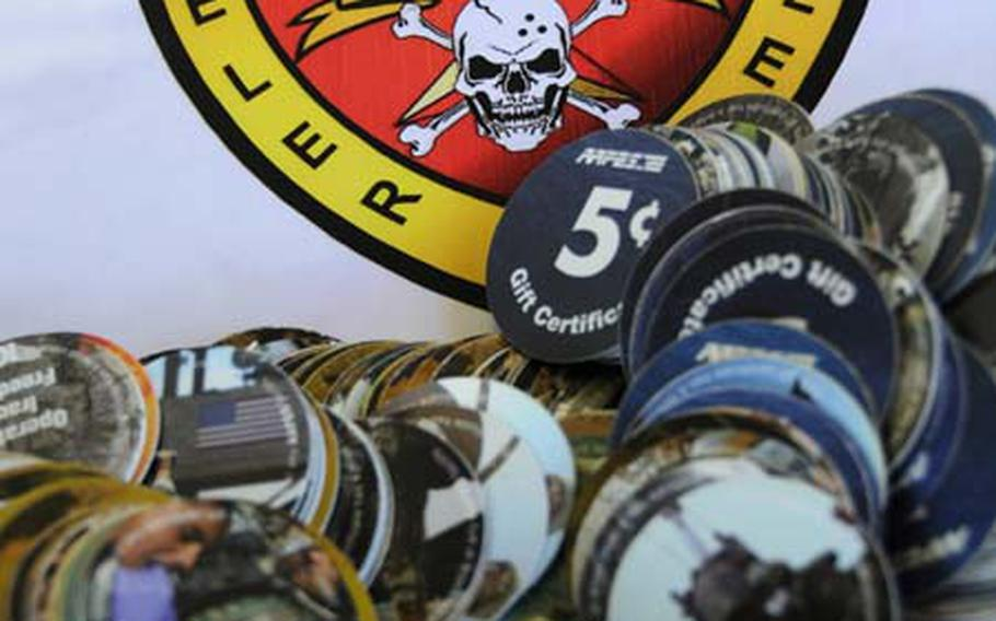 Marines and sailors of 3rd Reconnaissance Battalion, deployed to Al Asad Air Base in Anbar province, Iraq, donated more than $250 in pogs to the Okinawan-American Animal Rescue Society.
