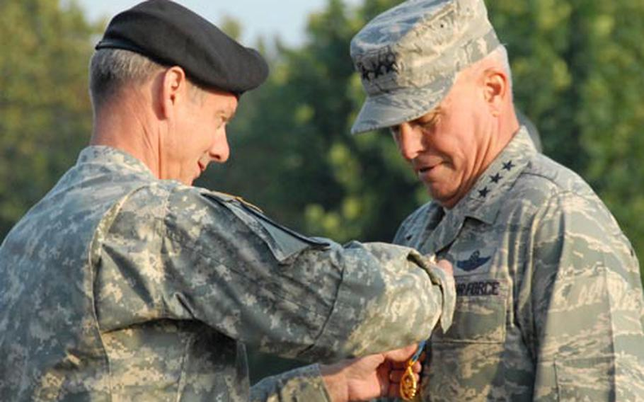 U.S. Forces Korea commander Gen. Walter Sharp pins a Distinguished Service Medal on Seventh Air Force commander Lt. Gen. Stephen Wood Friday at a ceremony honoring Wood, who will retire on Jan. 1, 2009.