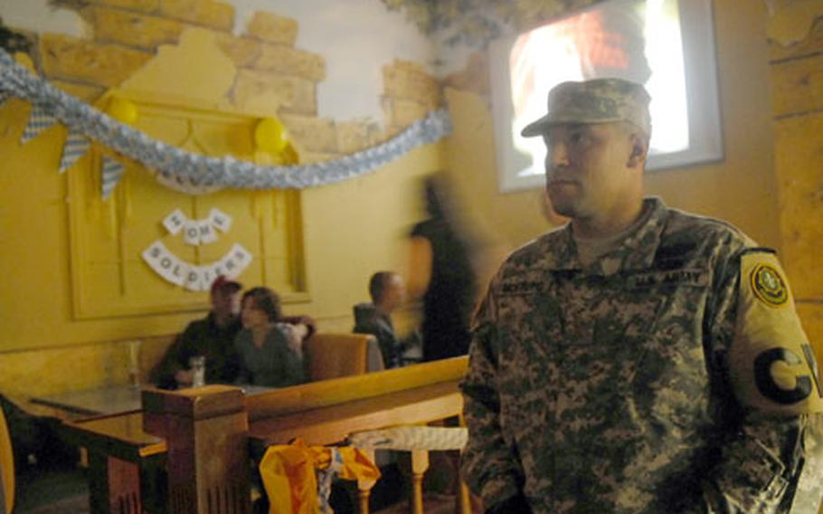 """Second Lt. Chris Montoyo keeps watch at a bar in Vilseck, Germany, during a """"courtesy patrol"""" aimed at making sure soldiers recently back from Iraq stay out of trouble."""