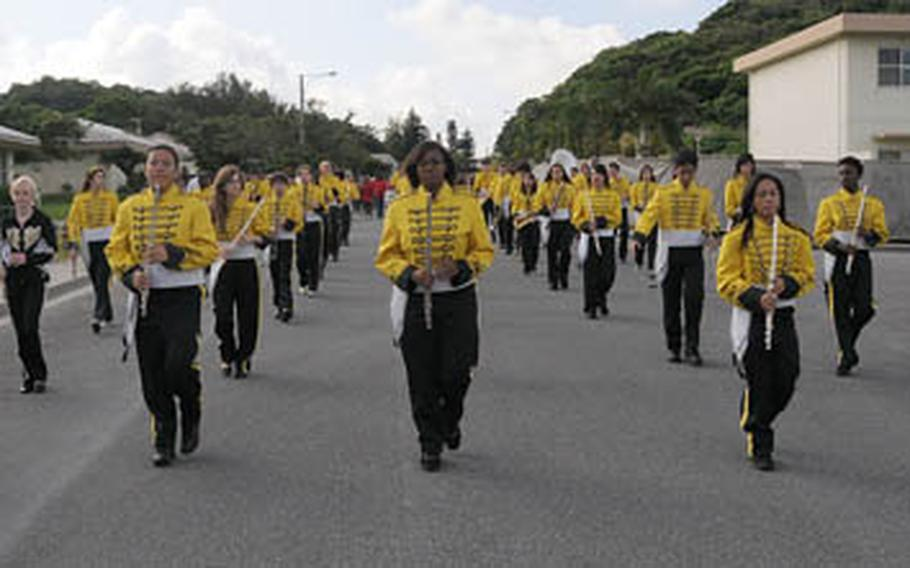 Kadena High School's new marching band marches at he head of Kadena Elementary School's Red Ribbon parade in one of the base's residential areas recently.