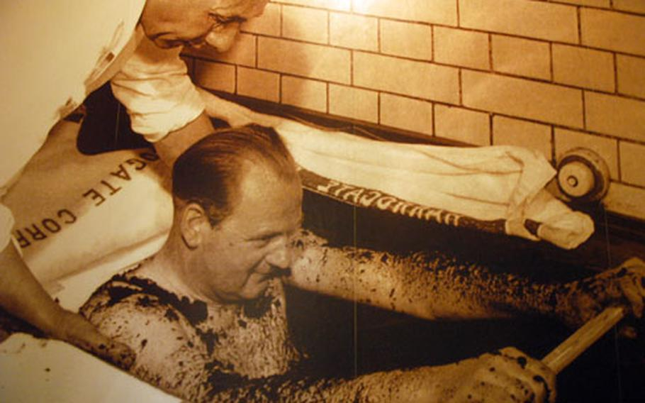 A man gets a spa treatment in one of the historic photos gracing the Royal Pump House Museum.
