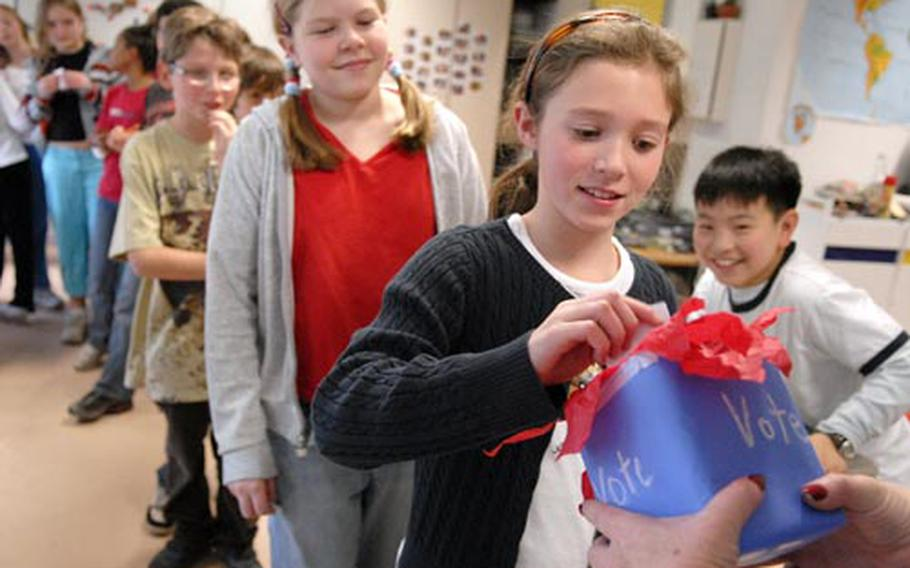 Emily Adams, a fifth-grader at Landstuhl Elementary School in Germany, casts her vote during a mock presidential election Tuesday at Landstuhl.