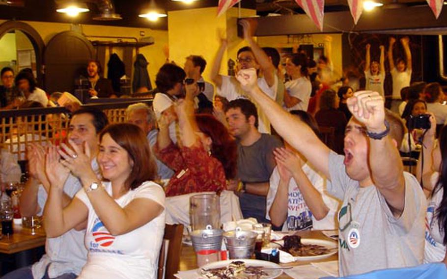 Supporters in Rome cheer shortly after 5 a.m. as CNN announces Barack Obama the winner in the 2008 presidential election at the Democrats Abroad election party.