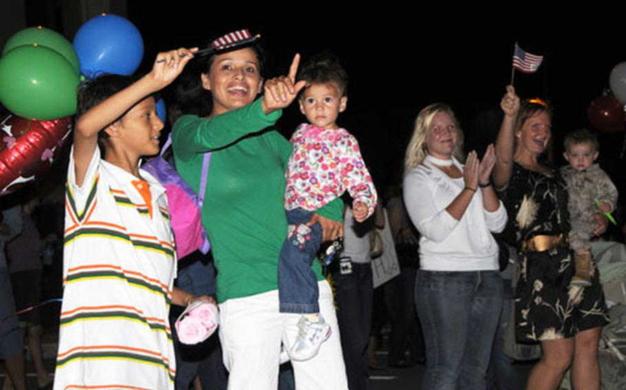 The families of 3rd Reconnaissance Battalion Marines and sailors began waving and cheering Thursday evening at Camp Schwab when they caught sight of the buses that carried their warriors home from a seven-month deployment to Iraq.