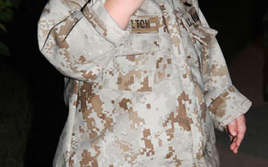 Isabella Charlton, 14 months, wears a uniform made from the pants of her father Staff Sgt. Chad Charlton's uniforms in honor of his return to Camp Schwab, Okinawa.