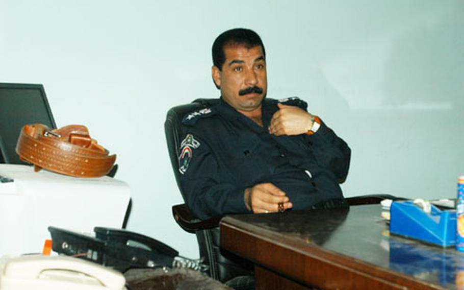 Col. Faroq Taih Hardan, Haditha's chief of police, sits at his office on Thursday.