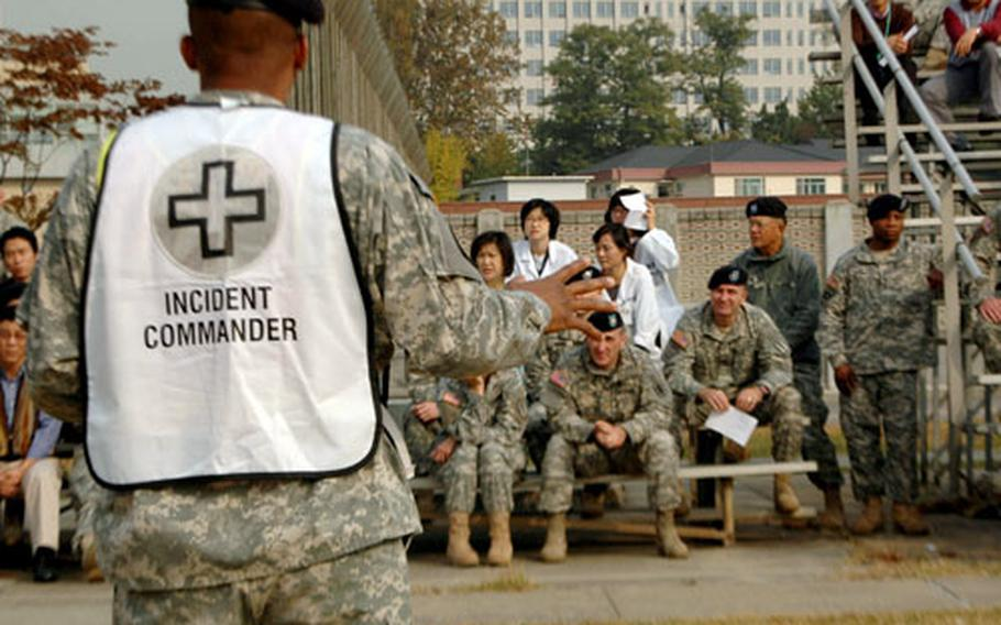 """Col. Ronald E. Smith, commander of the 65th Medical Brigade, speaks to the hospital staff after the drill. """"I think it went quite well,"""" he said. """"The reassuring part is that we are at a level where we can take care of patients"""" during an emergency."""