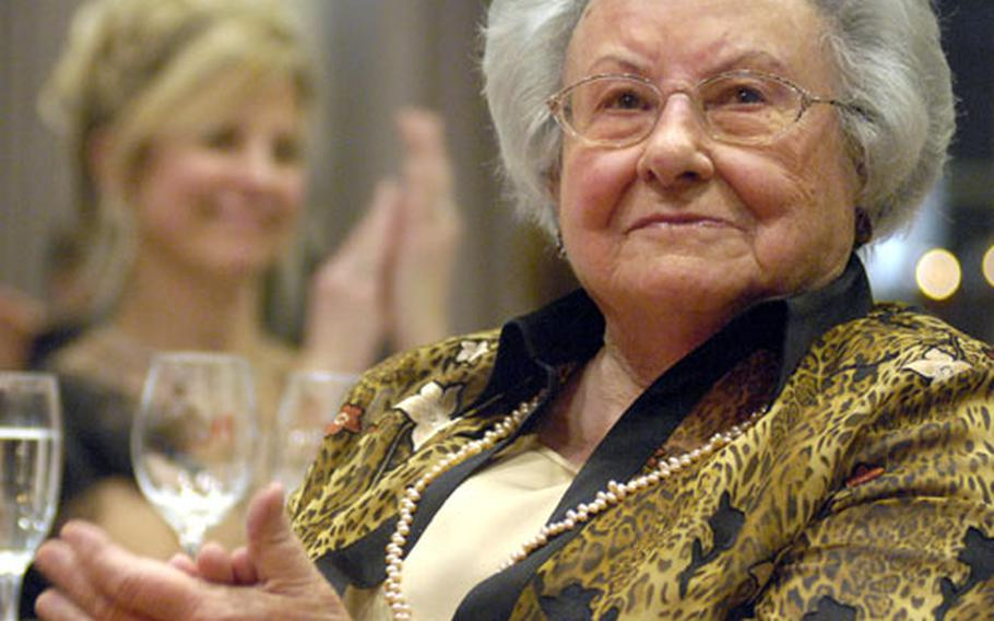 Gladys Fischer, a founding member and honorary president of the German-American Women's Club Heidelberg, reacts to a speech given by William Timken, the U.S. Ambassador to Germany, during a formal banquet Friday in downtown Heidelberg.