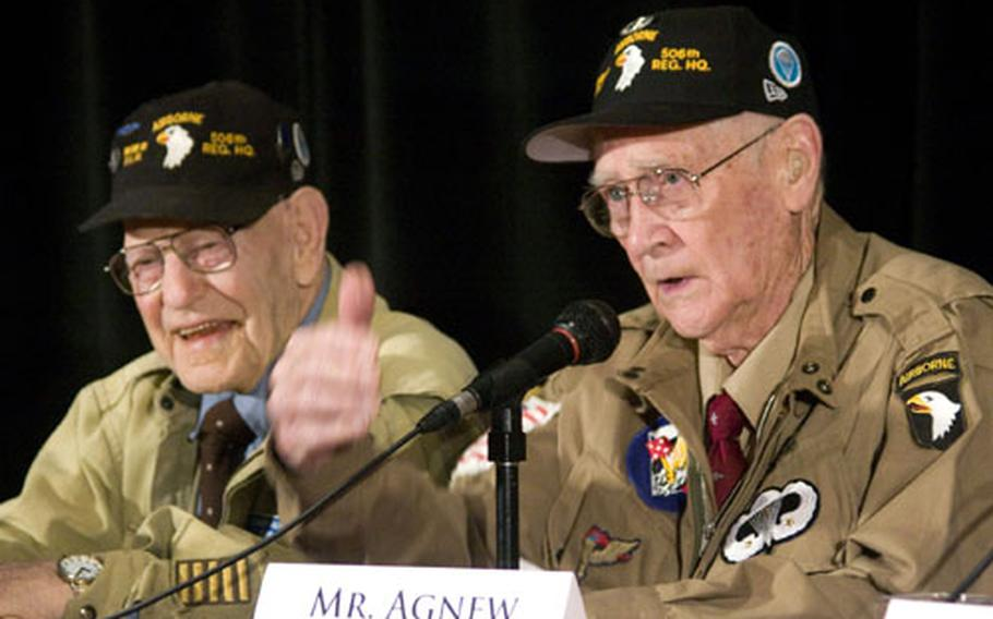 """Jake McNiece, left, enjoys the story being told by fellow """"Filthy Thirteen"""" paratrooper Jack Agnew during the American Veterans Center's 2008 annual conference in Washington, D.C."""