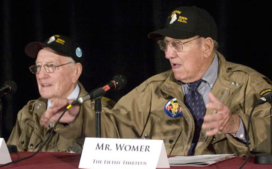 """Robert Cone, left, listens as fellow """"Filthy Thirteen"""" paratrooper Jack Womer talks about their World War II experiences."""
